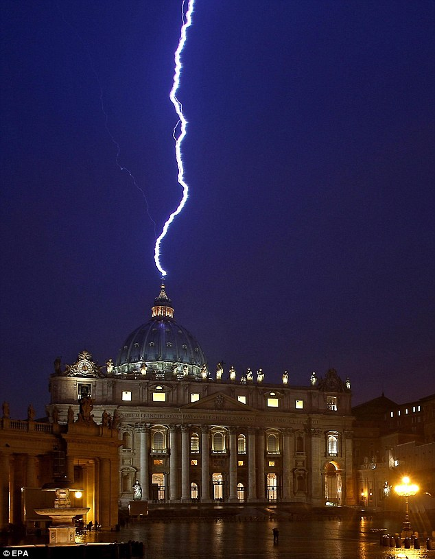 Lighting strikes the basilica of St.Peter's dome earlier this evening during a storm that struck Rome on the same day Pope Benedict XVI announced his resignation