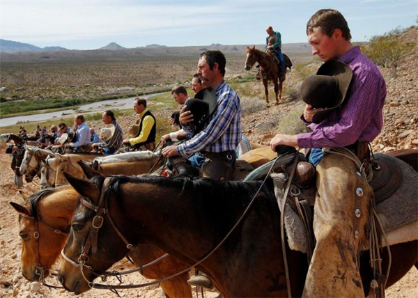 Jason Bean / AP (Bundy Ranch protesters observe the National Anthem.)