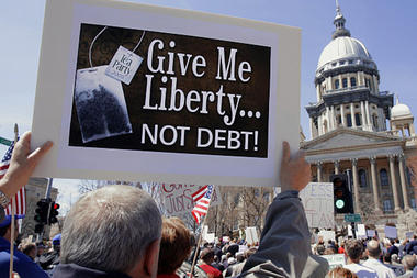 A tea party member participated in a tax day rally at the Illinois State Capitol in Springfield last year. (Seth Perlman/AP/File )
