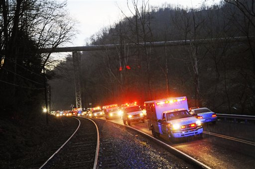 Emergency vehicles leave the entrance to Massey Energy's Upper Big Branch Coal Mine Monday, April 5, 2010 in Montcoal, WV