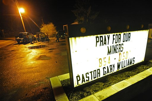 Community members gather at The New Life Assembly Church in Whitesville, W.Va., near Massey Energy's Upper Big Branch Coal Mine Monday, April 5, 2010 in Montcoal, W.Va. An explosion rocked a remote coal mine with a history of safety problems Monday, killing 12 workers and trapping 10 others thousands of feet underground. (AP Photo/Jeff Gentner)