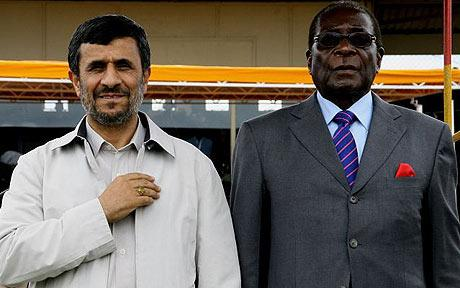 Zimbabwe's President Robert Mugabe (R) stands with Iranian President Mahmoud Ahmadinejad at a parade in Bulawayo  Photo: AFP