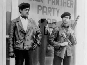 This is a 1960s photo of Black Panther chairman Bobby Seale, left, wearing a Colt .45 pistol, and Huey P. Newton, the militant organization's defense minister, with a bandoleer and shotgun. (Associated Press/San Francisco Examiner file photo)
