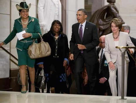 WASHINGTON, DC - MARCH 14:  U.S. President Barack Obama (2nd R) leaves a House Democratic Caucus meeting with (L-R) U.S. Rep. Frederica Wilson (D-FL) (L),U.S. Rep. Terri Sewell (D-AL) (2nd L) and House Minority Leader Nancy Pelosi (D-CA) during his third day of meetings with members of Congress March 14, 2013 in Washington, DC. With tax reform, spending cuts, gun control and immigration on the agenda, Obama will meet with Senate Republicans and House Democrats today.  (Photo by Chip Somodevilla/Getty Images)