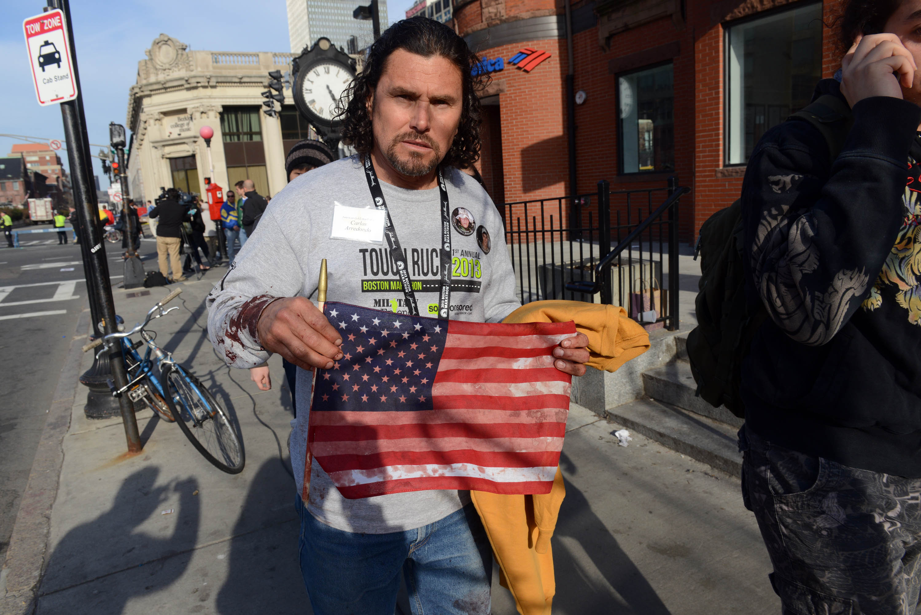 BOSTON, MA - APRIL 15:  Carlos Arredondo, who was at the finish line of the 117th Boston Marathon when two explosives detonated, leaves the scene.  (Photo by Darren McCollester/Getty Images)