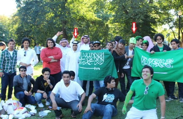 Here's Ali- Alharbi at a picnic with a buddy in an Anonymous mask. via The Jester