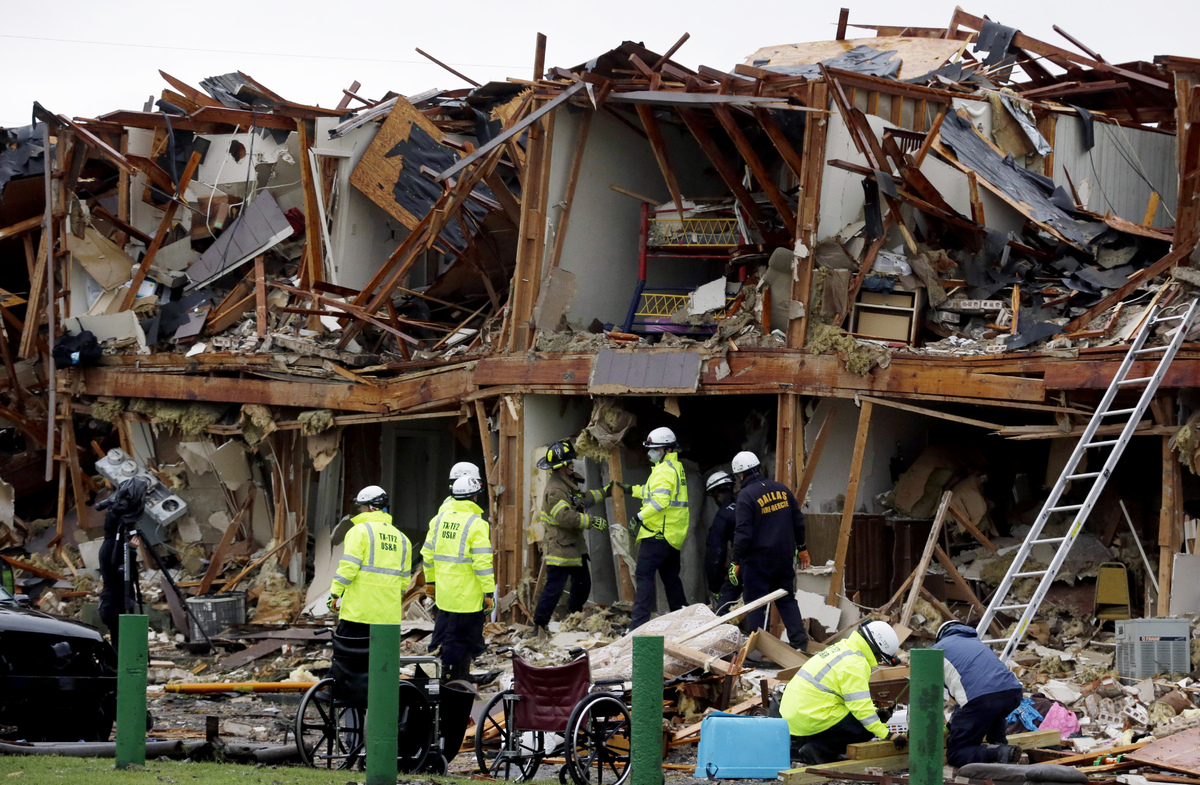 Firefighters conduct a search and rescue of an apartment destroyed by an explosion at a fertilizer plant in West, Texas, Thursday, April 18, 2013. A massive explosion at the West Fertilizer Co. killed as many as 15 people and injured more than 160, officials said overnight. (AP Photo/LM Otero)