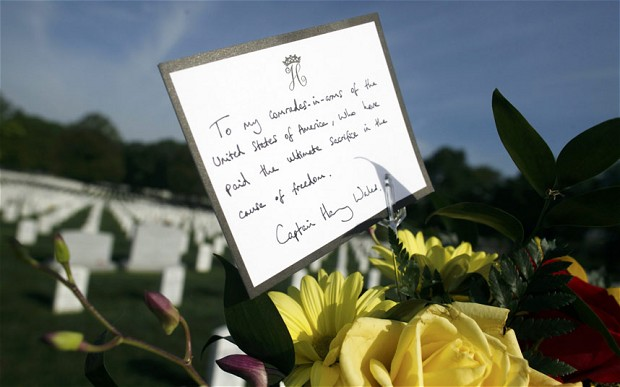 A hand-written note left by Prince Harry: To my comrades-in-arms of the United States of America, who have paid the ultimate sacrifice in the cause of freedom. Captain Harry Wales. Photo: Getty Images