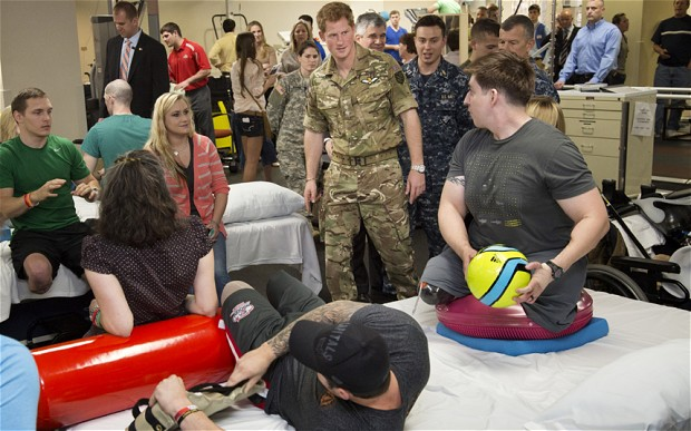 Prince Harry was introduced to Staff Sergeant Tim Payne, right Photo: Getty Images