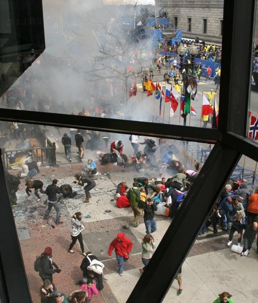 This Monday April 15, 2013 photo provided by Ben Thorndike shows the scene following an explosion at the Boston Marathon.