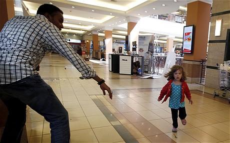 Portia Walton is helped to escape by Abdul Haji GORAN TOMASEVIC/REUTERS