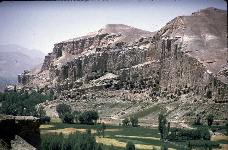 """According to UNESCO, """"The cultural landscape and archaeological remains of the Bamiyan Valley represent the artistic and religious developments which from the 1st to the 13th centuries characterized ancient Bakhtria, integrating various cultural influences into the Gandhara school of Buddhist art. The area contains numerous Buddhist monastic ensembles and sanctuaries, as well as fortified edifices from the Islamic period. The site is also testimony to the tragic destruction by the Taliban of the two standing Buddha statues, which shook the world in March 2001."""""""
