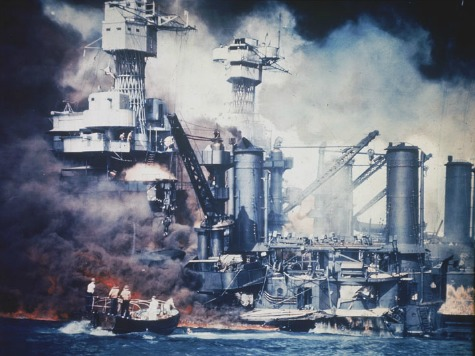 In this U.S. Navy file photo, a small boat rescues a USS West Virginia crew member from the water after the Japanese bombing of Pearl Harbor, Hawaii on Dec. 7, 1941 during World War II. Two men can be seen on the superstructure, upper center. The mast of the USS Tennessee is beyond the burning West Virginia. On Dec. 7, 1941, Japanese Imperial Navy navigator Takeshi Maeda guided his Kate bomber to Pearl Harbor and fired a torpedo that helped sink the USS West Virginia. President Barack Obama on Thursday Dec. 6, 2012 issued a proclamation declaring Dec. 7 a day of remembrance in honor of the 2,400 Americans who died at Pearl Harbor. He urged federal agencies, organizations and others to fly their flags at half-staff. (AP Photo, File)