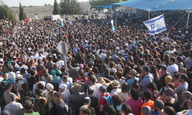 Tens of thousands Israelis attend the joint funeral of Gilad Shaer, 16, Naftali Frenkel, 16, and Eyal Ifrach, 19, in the central Israeli town of Modiin on July 1, 2014. Photograph: GIL COHEN-MAGEN/AFP/Getty Images