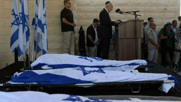 President Shimon Peres delivering a eulogy next to the flag-draped bodies of Naftali Fraenkel, Gil-ad Shaar and Eyal Yifrach at their funeral July 1, 2014 (photo credit: Chaim Tzach) Read more: Today has become a national day of mourning, PM says as teens buried | The Times of Israel