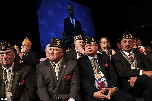 Not buying it: An estimated 10,000 American Legionnaires registered to attend the convention in Charlotte, but few of them were on their feet clapping for the commander-in-chief