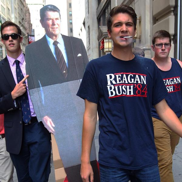 Students counter protested environmental demonstrators on Wall Street Tuesday by carrying a life-size cutout of President Ronald Reagan to the iconic financial location. (Image source: Campbell Moore)
