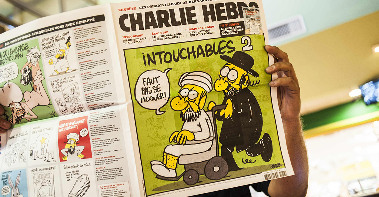 """A 2012 issue featuring the satirical drawing titled """"Intouchables 2."""" (Photo: Newscom)"""