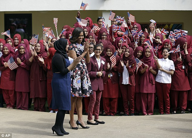 Ultra-religious:  Michelle Obama visits the Mulberry School, probably one of the  least diverse schools in Britain.
